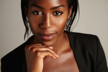 black woman's closeup porttrait watching at camera