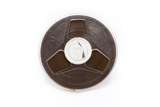Vintage magnetic audio tape reel on white background