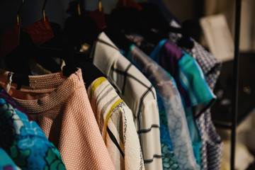 Clothes on racks in a fashion boutique