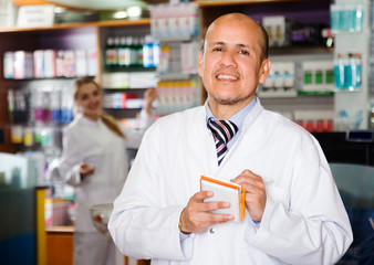 Man pharmacist in chemist's shop