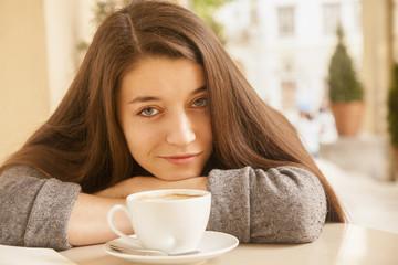 Coffee. Beautiful Girl Drinking Coffee in Cafe. Beauty Model Wom