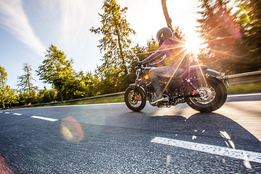 Man riding the motorcycle. On the road!