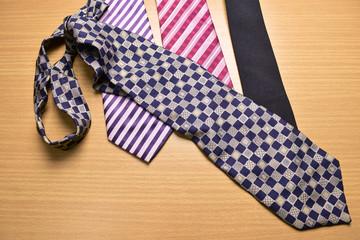 Necktie, Assorted colorful Necktie on Wood Background