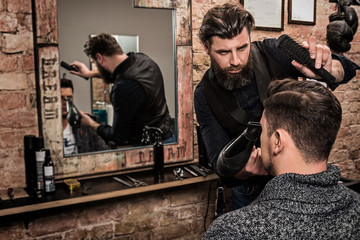 Hairdresser during work with a client