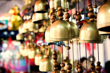 Chinese temple bell hanging in the evening.