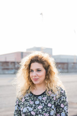 Young blonde curly hair woman