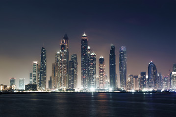 panorama of skyscrapers in Dubai Marina, sunset time, UAE
