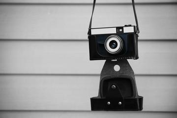 Vintage camera on light wooden background