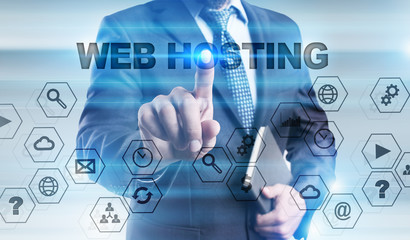 """Businessman is pressing button on touch screen interface and selecting """"Web hosting""""."""