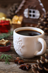 Cup of coffee, pine cones and Christmas-tree decorations
