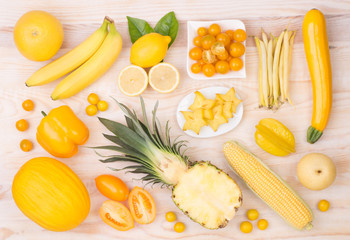Yellow fruit and vegetables, top view