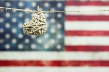 Heart hanging by rustic American flag
