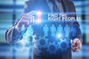 Fototapeta FInd the right people. Businessman select people icon on virtual screen. HR management concept obraz