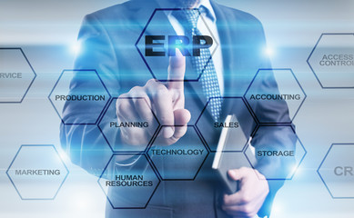 Businessman pressing button on virtual screen and select ERP concept.