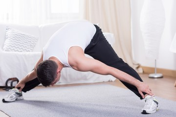 Young guy stretching his body