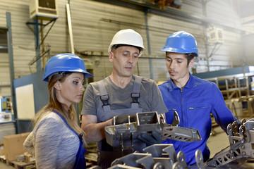Metalwork apprentice in metallurgy training class