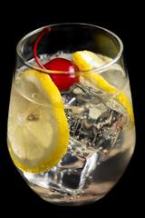 Tom Collins cocktails on black background