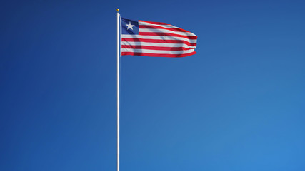 Liberia flag waving against clean blue sky, long shot, isolated with clipping path mask alpha channel transparency