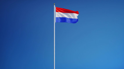 Holland flag waving against clean blue sky, long shot, isolated with clipping path mask alpha channel transparency