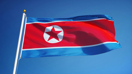 North Korea flag waving against clean blue sky, close up, isolated with clipping path mask alpha channel transparency Wall mural