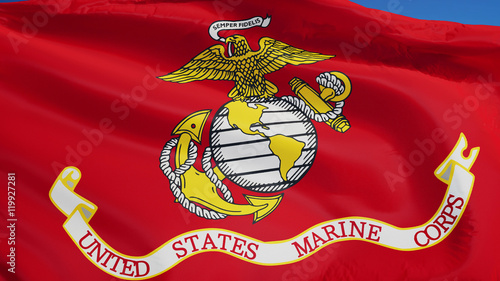 United States Marine Corps flag waving against clean blue sky, close