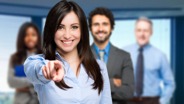 Smiling woman pointing her finger to you
