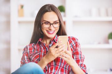 Smiling female using smartphone