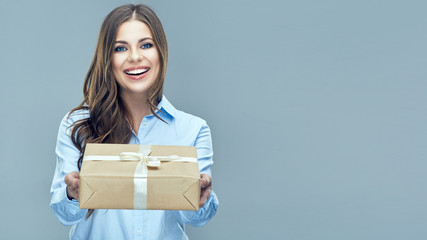 Business woman holding paper gift box