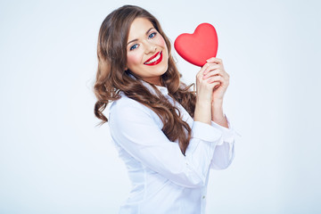 Woman heart holding, Smiling girl isolated portrait.