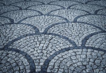 stone pavement blocks stored in fan shape