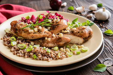 Baked chicken breast with boiled buckwheat and steamed beetroot and onion