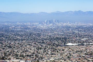 Aerial view of Los Angeles in the United States. City landscape with a mountain peak and downtown.
