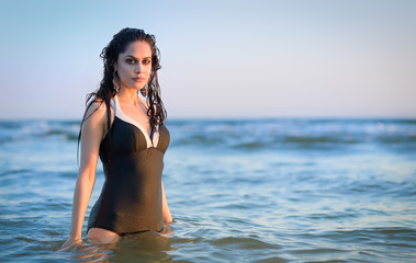 Pretty brunette swimming in Swedish sea