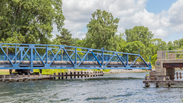 Swing bridge is opening on Murray Canal, Quinte West, Ontario, Canada  The Murray Canal was built between 1882 and 1889, is an canal linking Lake Ontario with the Bay of Quinte, Ontario.