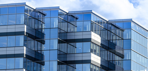 Photo Blinds City building Lines, glass and reflections of modern architecture. Glass panelled building of new office space in Moncton, New Brunswick. New commercial real estate in the city.