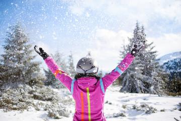 happy skier woman on mountain