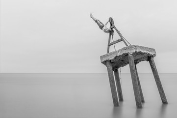 Old sea fishing boat windlass with very long exposure time with man lifting
