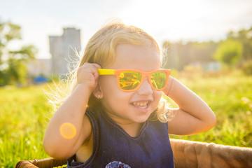 funny little girl in sunglasses