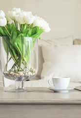 Coffee cup on table with Flowers Sofa Pillows Home decoration