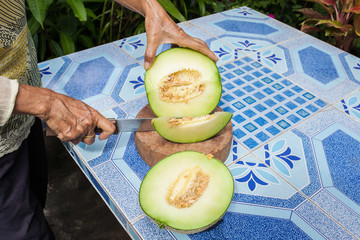 Melon on the table or Cantaloupe salad. Slices of melon on a tab