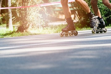 Rollerblading on asphalt road.