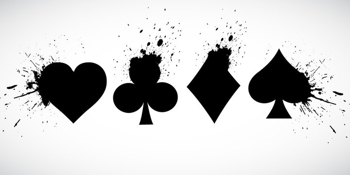 The suits of the deck of playing cards on a background of splashing. Grunge.