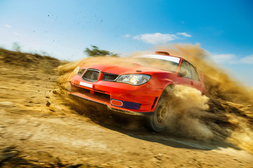 Poster Motorise Powerful red rally car in the drift on dirt road