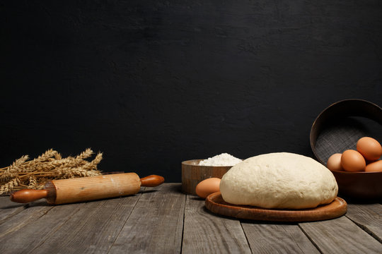 Dough on table with space for an object in bakery