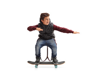 Cheerful boy riding a skateboard