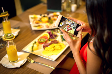 Taking food photos in restaurant