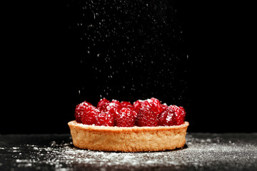 Tartlet with custard and fresh raspberries