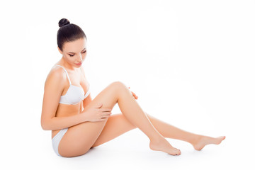 Healthy woman in underwear doing massage for her legs