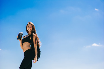Fitness girl with a shaker