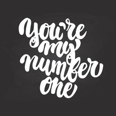 You're my number one- hand drawn lettering phrase isolated on the chalkboard background. Fun brush ink inscription for photo overlays, greeting card or t-shirt print, poster design